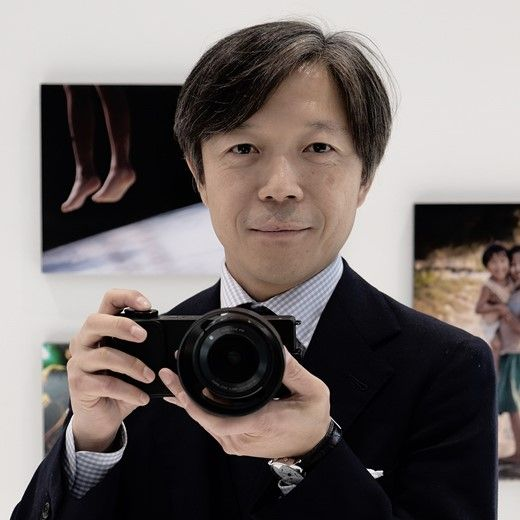 Kazuto Yamaki, CEO of Sigma, pictured at the CP+ 2014 show in Yokohama, Japan with the company's new dp2 Quattro