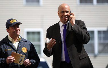 Newark Mayor Cory Booker pulled up on Elizabeth Avenue after a pedestrian was struck by a car and helped the individual into an ambulance, city officials said.