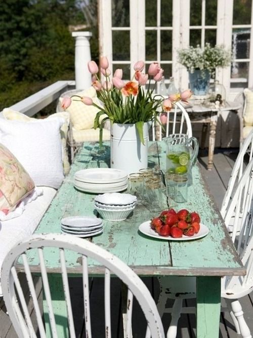 summer porch with aqua farm table