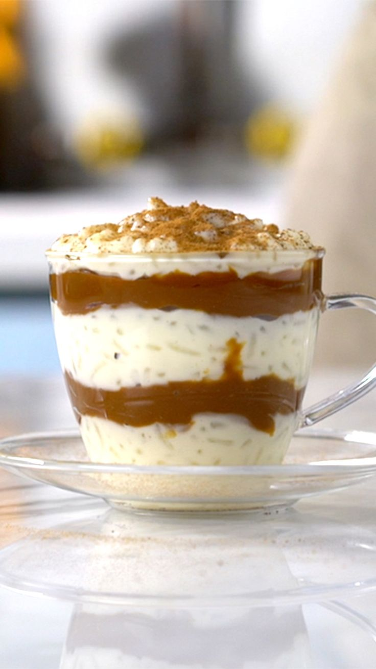 Recipe with video instructions: Take cinnamon-y rice pudding to the next level with rich dulce de leche. Ingredients: 1 cup rice, 2 cloves, 1 cinnamon stick, 4 ¼ cups milk, 1 can condensed milk, Ground cinnamon, 1 cup dulce de leche