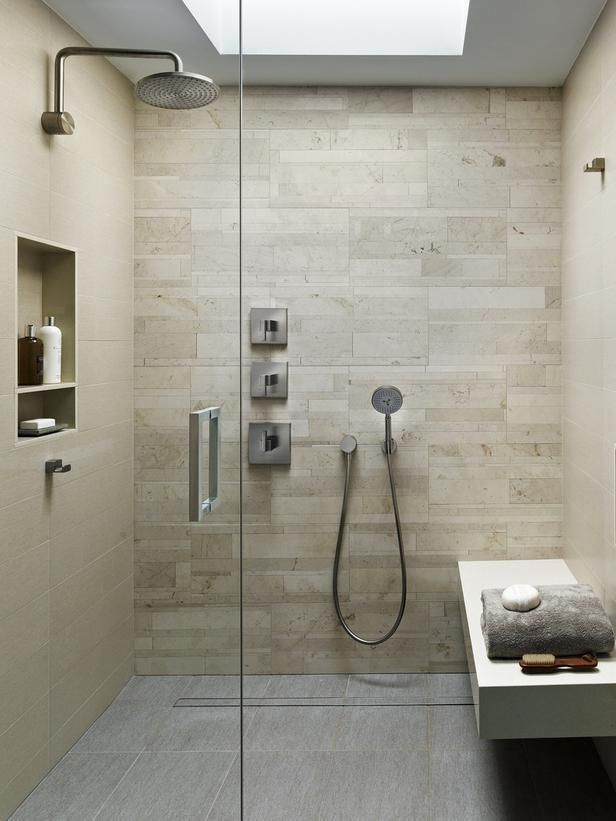 Shower - like tile, shampoo shelf, floating bench