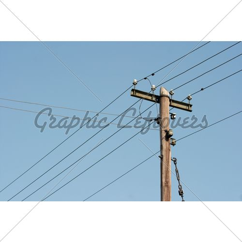 Old Wooden Electric Pillar Against Clear Blue Sky