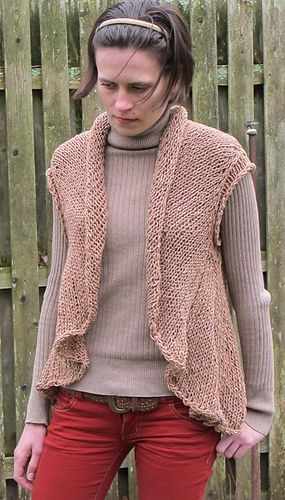 A cardigan vest, with a rolled collar that flows down into a draped cut away front and long back.