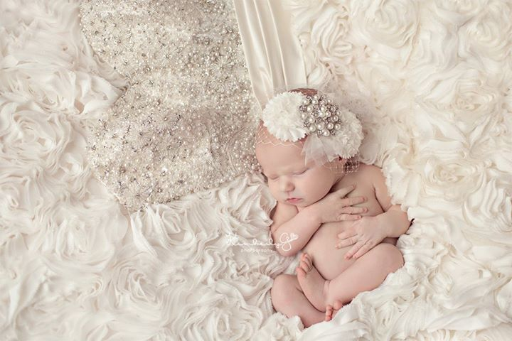 Newborn Girl picture with Mothers wedding dress.