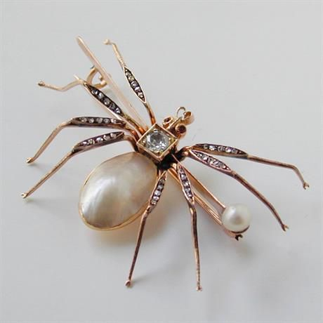 A LATE VICTORIAN PEARL AND DIAMOND SPIDER BROOCH