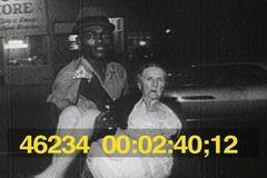 WATTS RIOTS OF 1965 - BLACK MAN RESCUES ELDERLY WHITE WOMAN