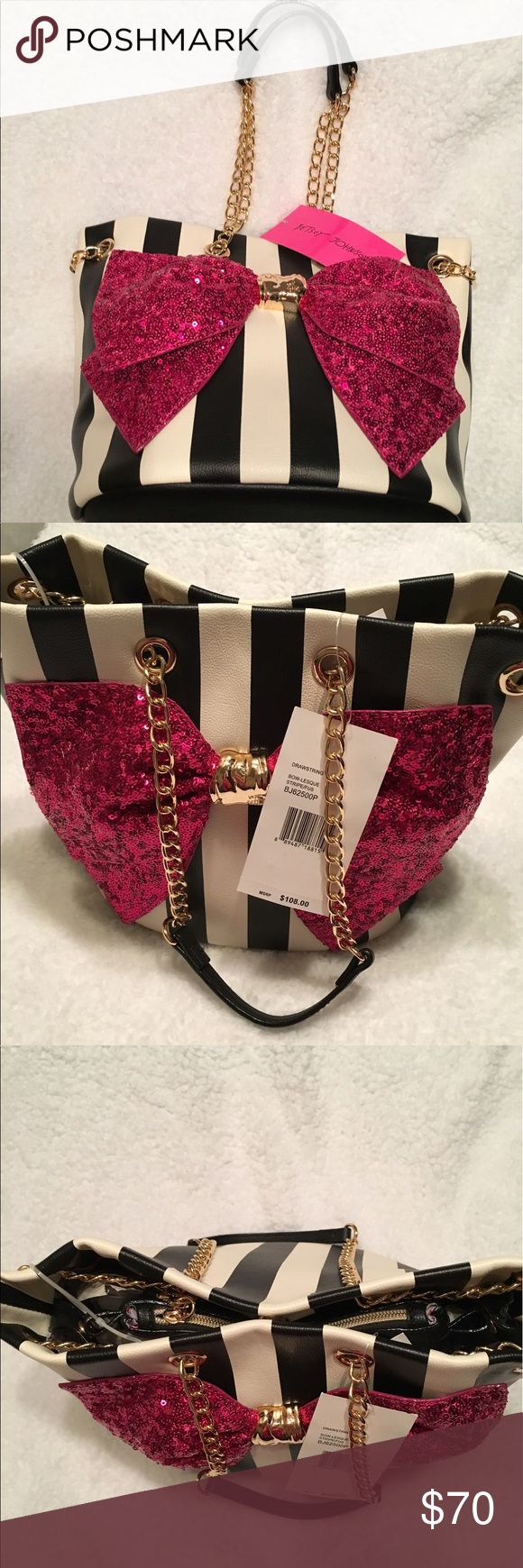 NWT Betsey Johnson black and white striped purse New Betsey Johnson black and white striped purse with pink sequin bow. Has gold chain handles. Button closure. Inside pocket with zipper and a large open pocket. Also comes with a makeup size black leather bag with zipper that can be buttoned to the inside of the purse for easy access. Black string attached to the inside of the purse with a key clip so you won't lose your keys. Adorable purse and very functional! Betsey Johnson Bags Shoulder…