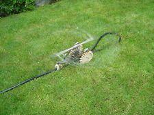 Lawncrest Yardminder traveling tractor sprinkler.