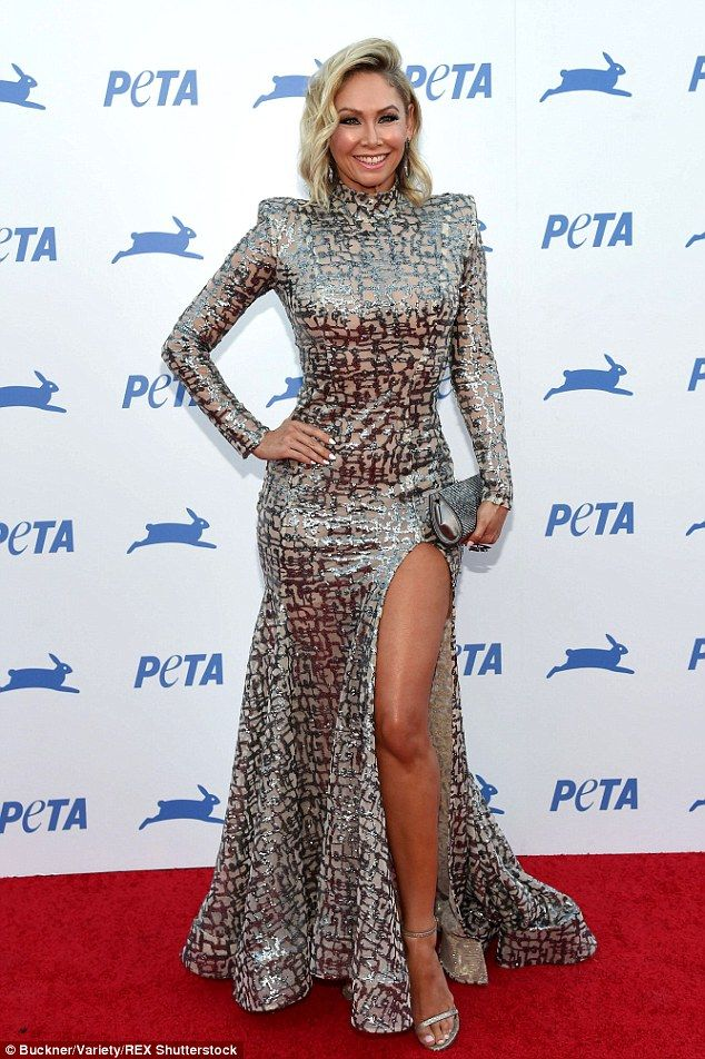 Hourglass: Kym Johnson showed off her dangerous curves in a metallic gown with thigh-high ...