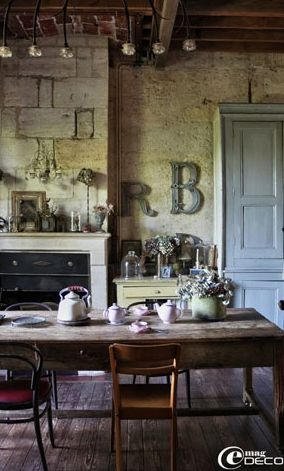 Rustic Tuscan style country kitchen.  Love the light blues and greens incorporated here.