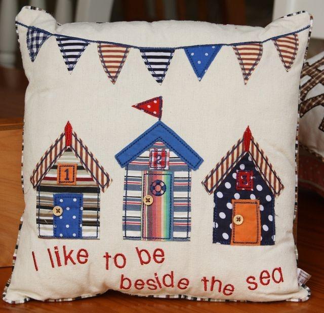 Seaside cushion with appliquéd beach huts – 30cm x 30cm