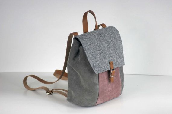 Rucksack made of high quality full grain leather, felt and shammy leather  Closes on the button hidden under the buckle  It has got regulated straps   Size: 25cm x 26cm x 17cm  It can be also made to order in size of 13 laptop   All products are handmade in our manufacture in Poland  Best material and quality
