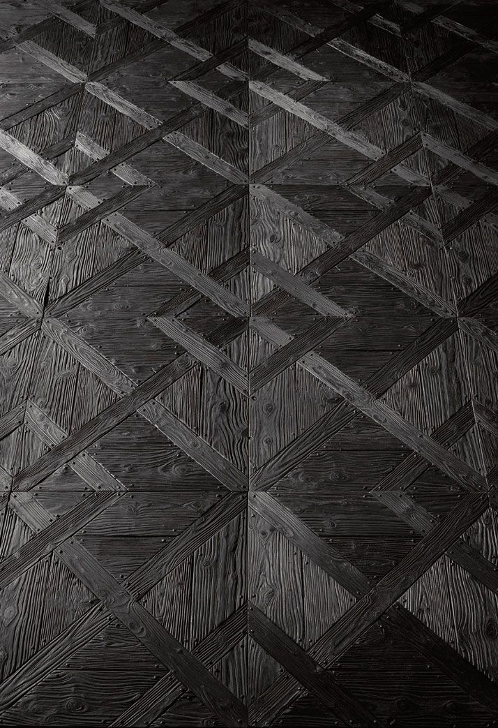 Recycled black parquet flooring by Henry Krokatsis
