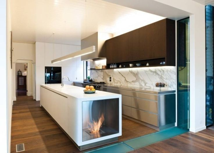 Cocinas de estilo moderno por ilumia.pl