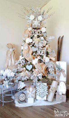 Winter Wonderland Glam Christmas Tree designed by Toni Roberts of Design Dazzle. Snow tipped branches, gold hydrangeas, white roses, lots of bling and touches of galvanized metal create this Winter Wonderland Glam Tree. MichaelsMakers
