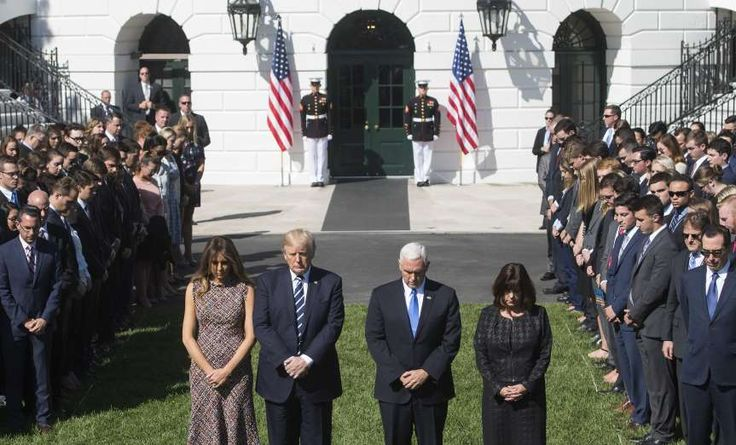 Las Vegas gunman kills at least 59 in shooting rampage, more than 500 others injured  -  October 2, 2017:  Las Vegas Shooting  -  US President Donald Trump, First Lady Melania Trump, US Vice President Mike Pence and his wife, Karen, participate in a moment of silence on the South Lawn of the White House in Washington, on Oct. 2, for the victims of the shooting yesterday in Las Vegas.