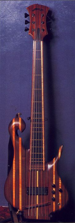 Carl Thompson 6-string bass - There's no chance whatsoever I would be able to play a 6-string fretless well, or even remotely decently. Still, hearing what Les Claypool does with this one is freaking awesome.  Luckily enough these are prohibitively expensive, so I won't do anything stupid.