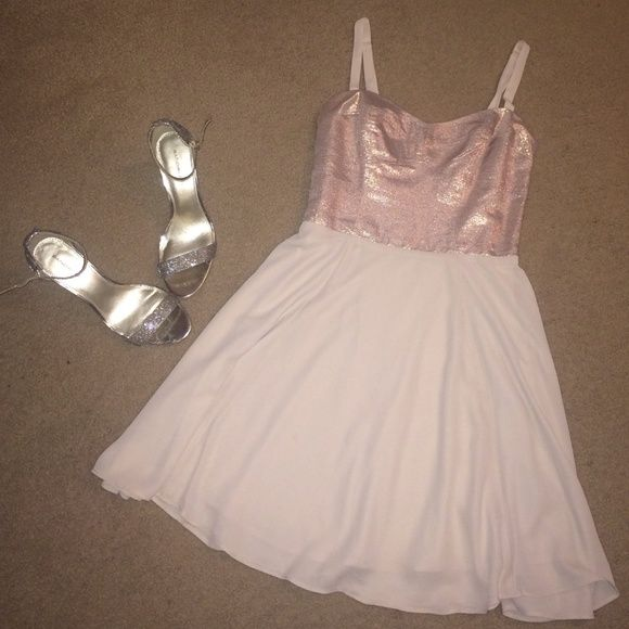 Ballerina Rose Express Dress! Super cute rose gold dress! Fitted up top then has a little bit if flare to it! Perfect for a night out!   worn once in Paris for a few hours at a show. Express Dresses Mini