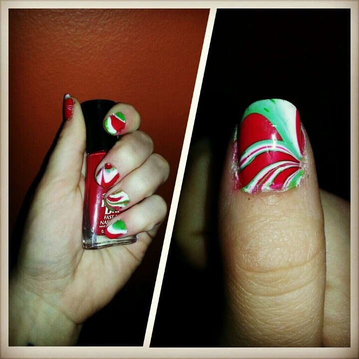 First time water marbling. First of 3 or 4 christmas manis to come. I used Red Carpet Gel Polish in white hot as the base and Sally Hansen in Rapid Red (Insta Dri), Just in Lime (Insta Dri) and White On (Xtreme Wear) for the marbling effect