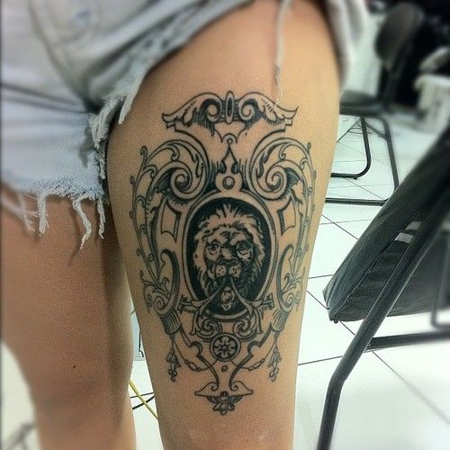 Awesome tattoo on the leg. A lion portrait with some ornaments around.