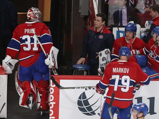 Canadiens goalie Carey Price looks toward the team's bench after being pulled from the game after goal by San Jose Sharks' Melker Karlsson during second period NHL action in Montreal on Friday, Dec. 16, 2016.