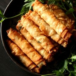 Thinly rolled up Turkish boreks called Cigarette borek. Filled with full Fat Turkish Feta cheese& parsley and fried.