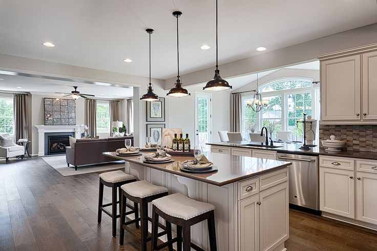 Love the dark bronze pendant lights in this Virginia kitchen! | Richmond American Homes