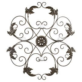 """Bring nature-inspired design to your living room, library, or office with this scrolling iron candle wall decor, perfect for casting a flickering glow over any decor.  Product: Candle wall decorConstruction Material: IronColor: IronFeatures: Made in IndiaPowder coatedAccommodates: (4) Votive candles - not includedDimensions: 32.3"""" H x 28.3"""" W x 3.9"""" D"""