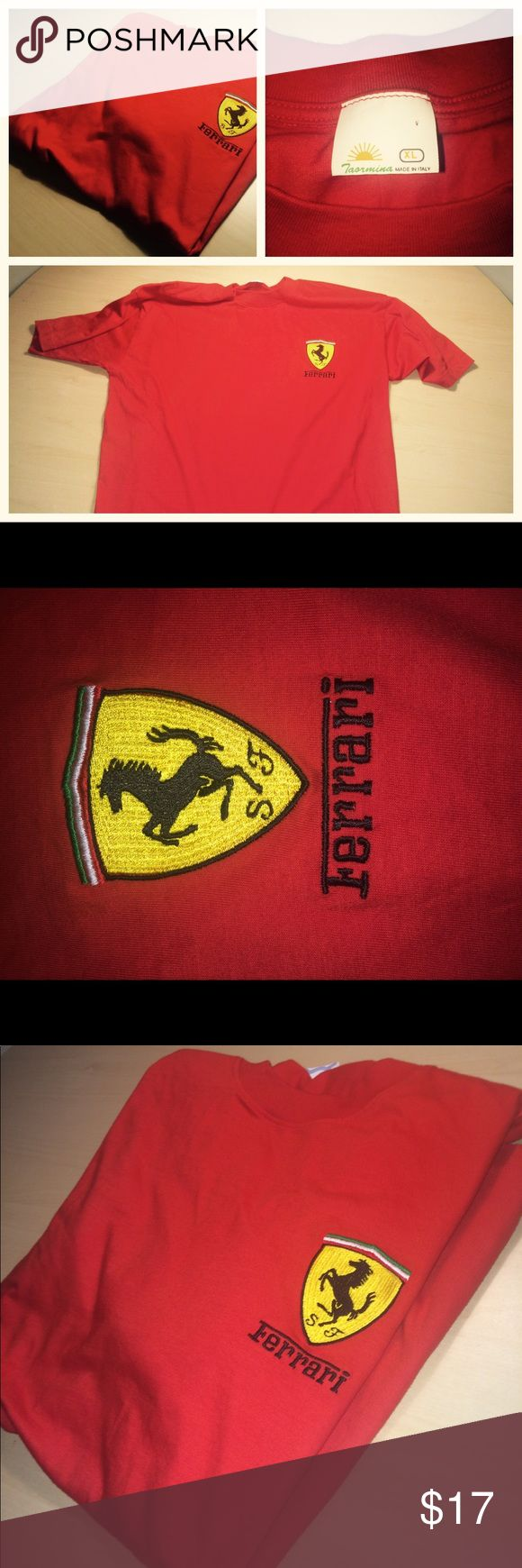 "Ferrari Men's XL Classic Red Crewneck T-Shirt Red, Like new. Classic and elegant XL tee shirt with Ferrari shield on left chest. Colors of Italian flag above shield; ""Ferrari"" in bold black letters below. Made in Italy; Taormina on tag. 100% Cotton. Perfect to wear to athletic games or out on a sunny day for a joyride. Ferrari Shirts Tees - Short Sleeve"