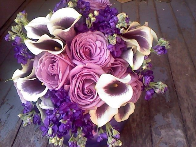 This Pretty Purple Bridal Bouquet Was Created With Lovely Lavender Roses Picaso Calla Lilies And