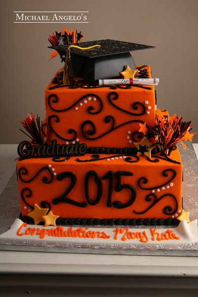 [[start tab]] Description A fun two tier square design that is iced in orange buttercream and accented with our famous swirls. A graduation kit is added on t
