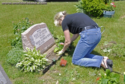 Plant Flowers To A Grave Site On Memorial Day
