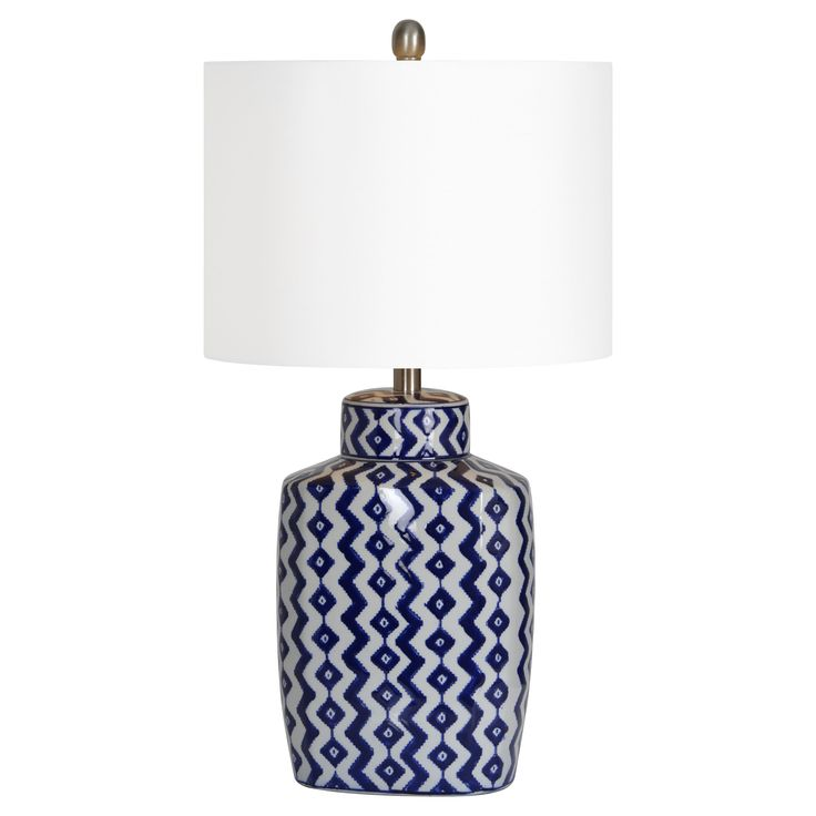 this classic blue and white porcelain lamp features a modern geometric design satin nickel accents