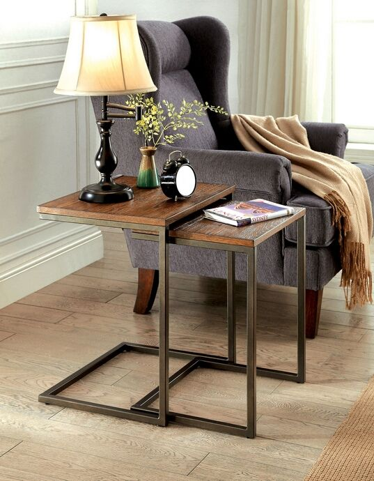 """2 pc Zia collection medium weathered oak finish wood and metal frame nesting table set . Measures 18"""" x 15"""" x 22"""" H. Smaller table measures 16"""" x 13 1/4"""" x 20 1/2"""". Some assembly required."""