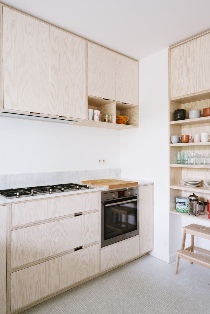 Spice cabinet like this? Cabinets up top, maybe some shelves for cute stuff or cookbooks. Then on the bottom space for the stool to slide under. That stepstool has to go in the kitchen somewhere this time.