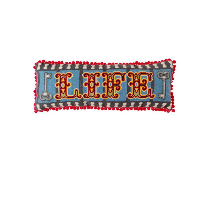 LIFE   £125.00 Designed by the fabulous Emily Peacock, our cushion asks what really is 'life'? Inspired by graffiti in a prison cell, this cross stitched tapestry with strong graphic lettering has a poignant double meaning.