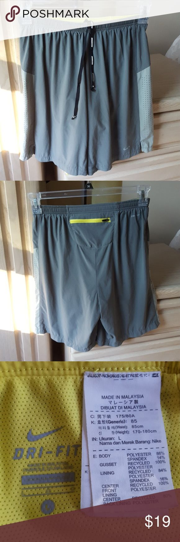 """Nike Shorts Nike Dri-Fit shorts. Excellent condition. Wolf grey with yellow interior. Nike Pro Combat  Dry Training Short. 10"""" inseam for ease of movement. Rear zippered pocket for storage and a secure stretch waistband w/drawstrings. *Could be worn as a boys' large or a women's M. Waist is appx 26""""       ♥️From a smoke & pet free home♥️ Nike Shorts"""