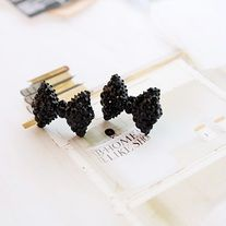This black bow/ribbon stud earrings is studded with black rhinestone crystals.