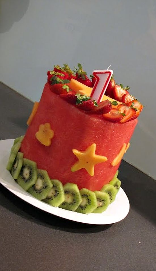 birthday cake made only from fruit. great idea if you aren't sweet on feeding your baby refined sugar.