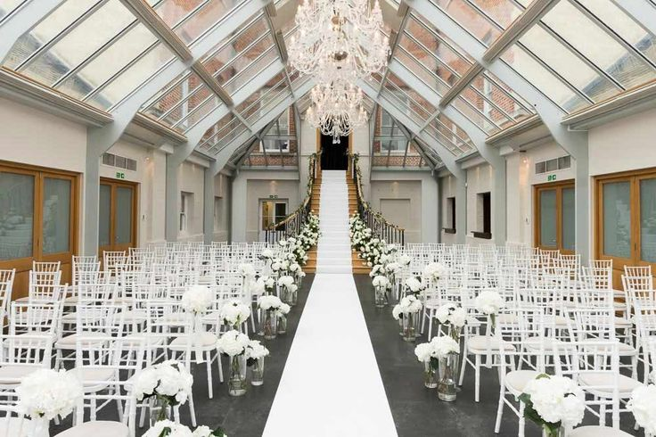 all white flower staircase ceremony room botleys mansion the atrium surrey