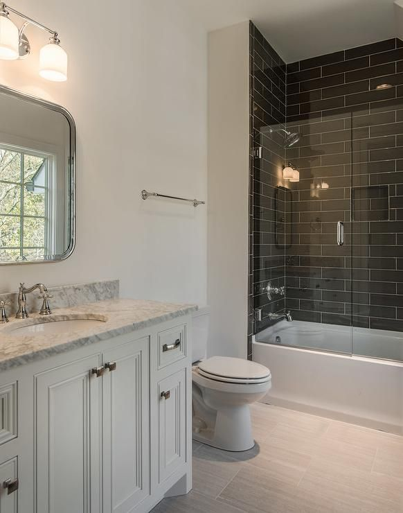 Fantastic bathroom features a white washstand topped with