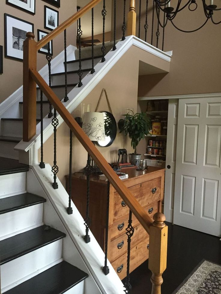 We recently had our oak spindles replaced with wrought iron ones in order to update the look of our railings.  That along with a coat of paint on the bottom mad…