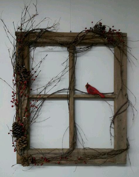 Window frame with grapevine wrapped around with cardinal sitting one middle frame