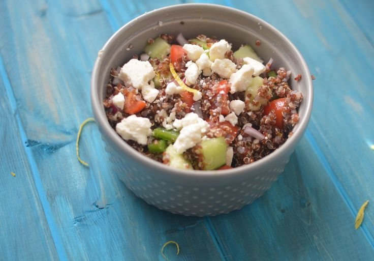 This Greek Quinoa Salad is brimming with tomatoes, cucumbers, a zesty lemon dressing and more!