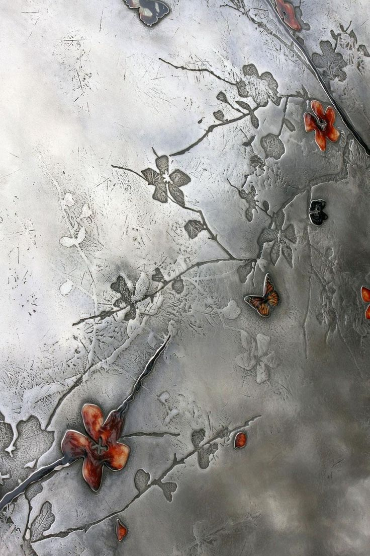 Plum Blossom Artwork Detail - Based Upon Fine Metal Workers Did the lift doors at the Conrinthia
