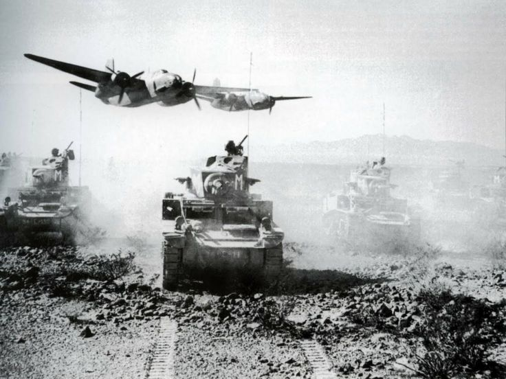 A column of M3 Stuart tanks of the 5th Armored Division, is training with Douglas A-20 Boston/Havoc bombers in the desert of California in October 1942. Just suspicion that this is propaganda photo & retouched to make aircraft look lower than really are.