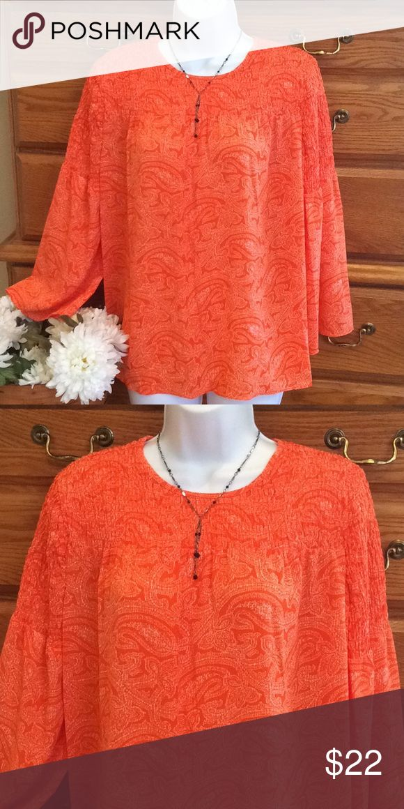 """Michael Kors Orange Top NWT Polyester and Elastane.  Brand new.  Approximately 26"""" in length and when laid flat and measured from armpit to armpit it is 23"""" across.  Orange paisley print.  Zippers in the back.  In the fourth picture I show the puckered part of the material, this has stretch and goes from the shoulders down to the supper part of the sleeves. KORS Michael Kors Tops Blouses"""