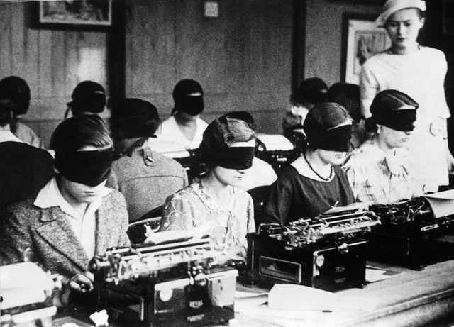 blindfolded typists (france, circa 1940)