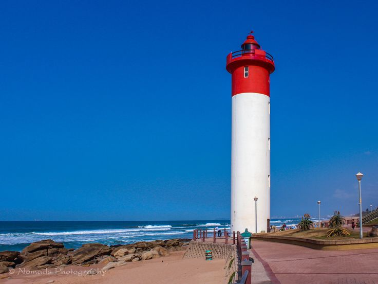 Icon - The Umhlanga Lighthouse is fully automated though its form is hand captured by local artists whose works are sold to foreigners chartering international waters with framed fragile portraits of this sturdy structure. Mistress of memorabilia and master of light since 1954, this 21m high circular concrete tower has a light range of 24 sea miles at a focal plane height of 25 meters above high sea level.