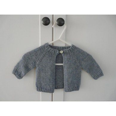 The cardigan is knitted from top down.